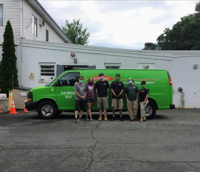 Photo of our crew with the team from Sweet Paws Rescue