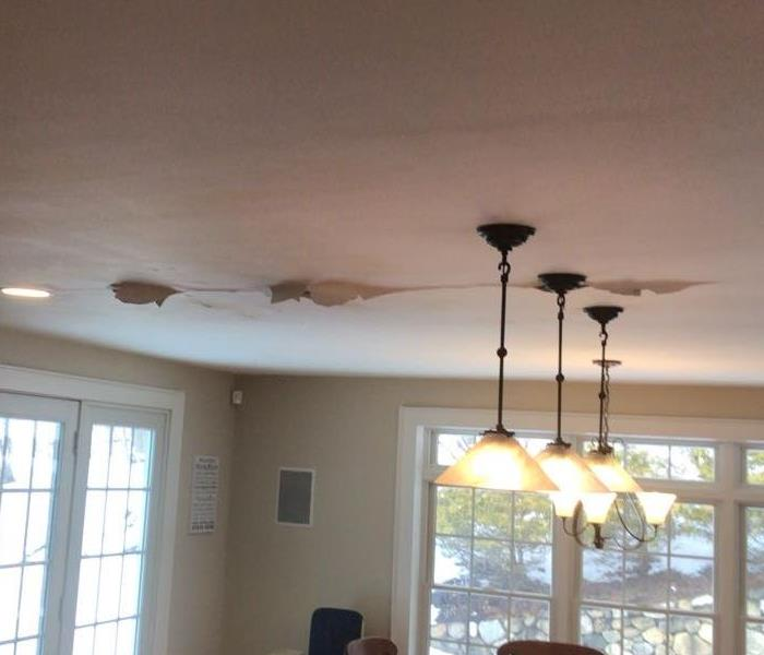 Photo of damp ceiling as a result of unrepaired water damage.